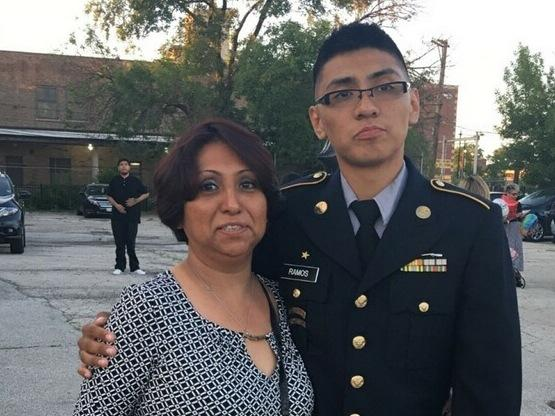 Lewis Ramos, 22, an operations specialist in the U.S. Army National Guard, stands with his mother, Rosa Elena Ramos, who arrived illegally 30 years ago from Mexico. He recently learned she would receive the protection by the time he leaves later this mont