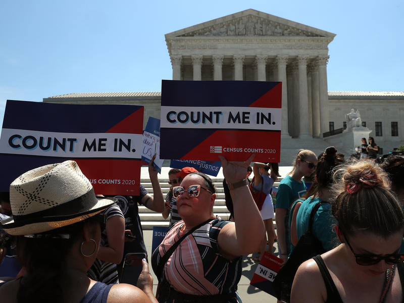 People gather in front of the U.S. Supreme Court last month as decisions are handed down, including on the census.