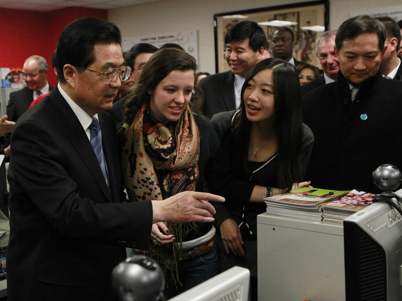 In this 2011 photo, Hu Jintao, then China's president, visits the Confucius Institute at the Walter Payton College Preparatory High School in Chicago. China established more than 100 Confucius Institutes, which provide language and culture programs, at U.
