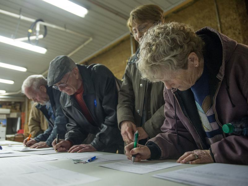 Caucus attendees sign in at a Democratic Party Caucus at Jackson Township Fire Station on Feb. 1, 2016, in Keokuk, Iowa. The DNC has scrapped a virtual caucus plan for 2020.
