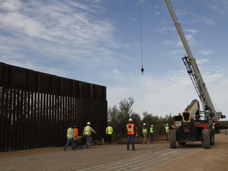 Workers break ground on new border wall construction about 20 miles west of Santa Teresa, N.M., last month. The Trump administration has started the arduous process of cancelling $3.6 billion in military construction projects to fund its plans to build mo