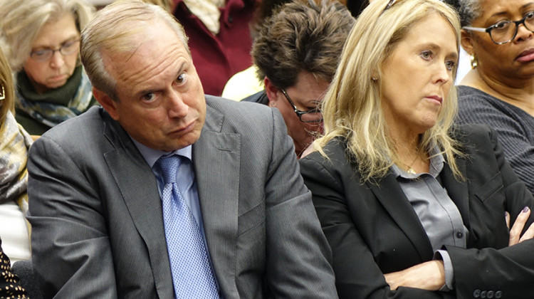 Jon Hage, CEO of Charter Schools USA, and Sherry Hage, CEO of Noble Education Initiative, listen to members of the Indiana Charter School Board at a meeting Friday, Dec. 13, 2019.