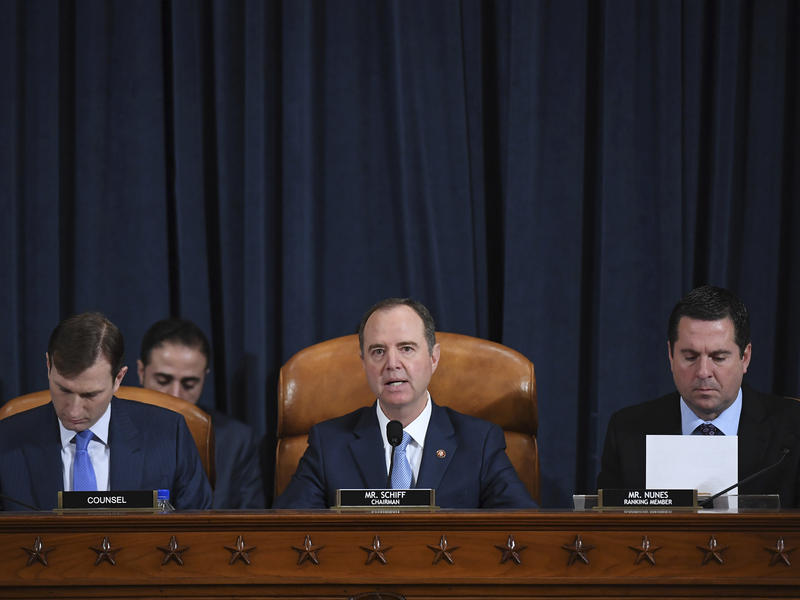 House Intelligence Committee Chairman Adam Schiff, D-Calif. (center); ranking member Rep. Devin Nunes of California (right); and committee counsel Daniel Goldman hold an impeachment inquiry hearing on Nov. 21. Schiff has released the panel's report on the