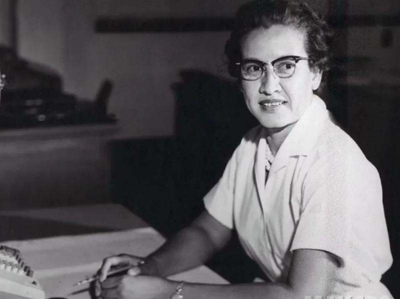 """NASA research mathematician Katherine Johnson at her desk at NASA Langley Research Center with a globe, or """"Celestial Training Device."""""""