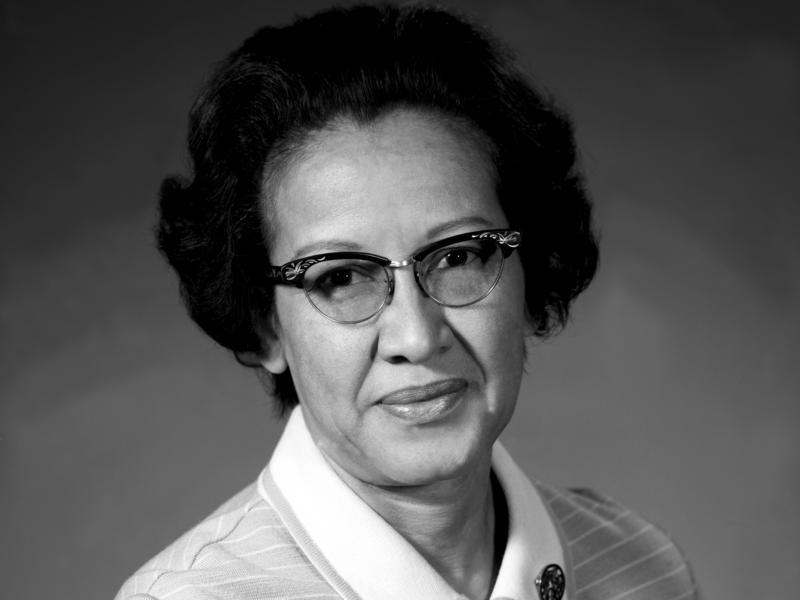 Katherine Johnson, seen here in 1971, performed crucial trajectory calculations for early NASA missions, overcoming racism and sexism.