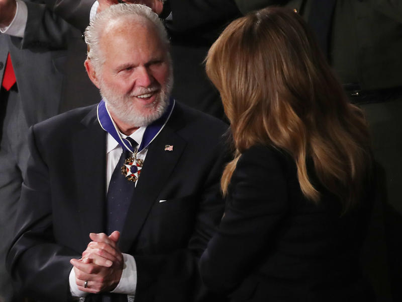 Rush Limbaugh says he intends to keep putting on his radio show despite his stage 4 lung cancer that he says has recently progressed. Here, he's seen reacting as first lady Melania Trump gives him the Presidential Medal of Freedom during the State of the