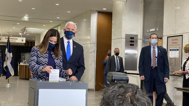 Vice President Mike Pence and wife Karen pence cast absentee ballots in Indianapolis Friday.