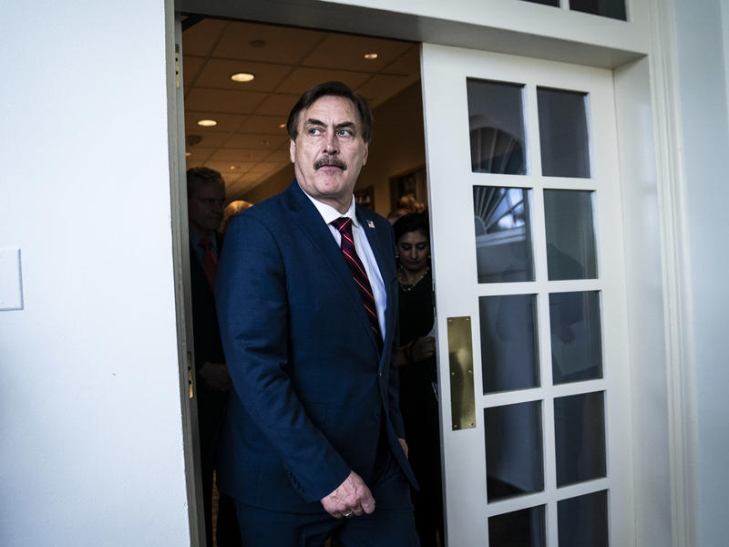 MyPillow CEO Mike Lindell walks out ahead of then-President Donald Trump at the White House in March 2020.