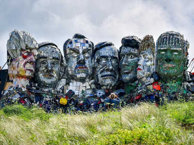 The Mount Recyclemore sculpture depicting G7 leaders is made from electronic waste. Artist Joe Rush created the sculpture to highlight the damage caused by disposal of electronic devices.