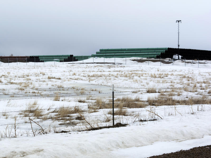 This March 11, 2020 photo provided by the Bureau of Land Management shows a storage yard in Montana for pipe that was to be used in construction of the Keystone XL oil pipeline. The developer has now canceled the controversial project.