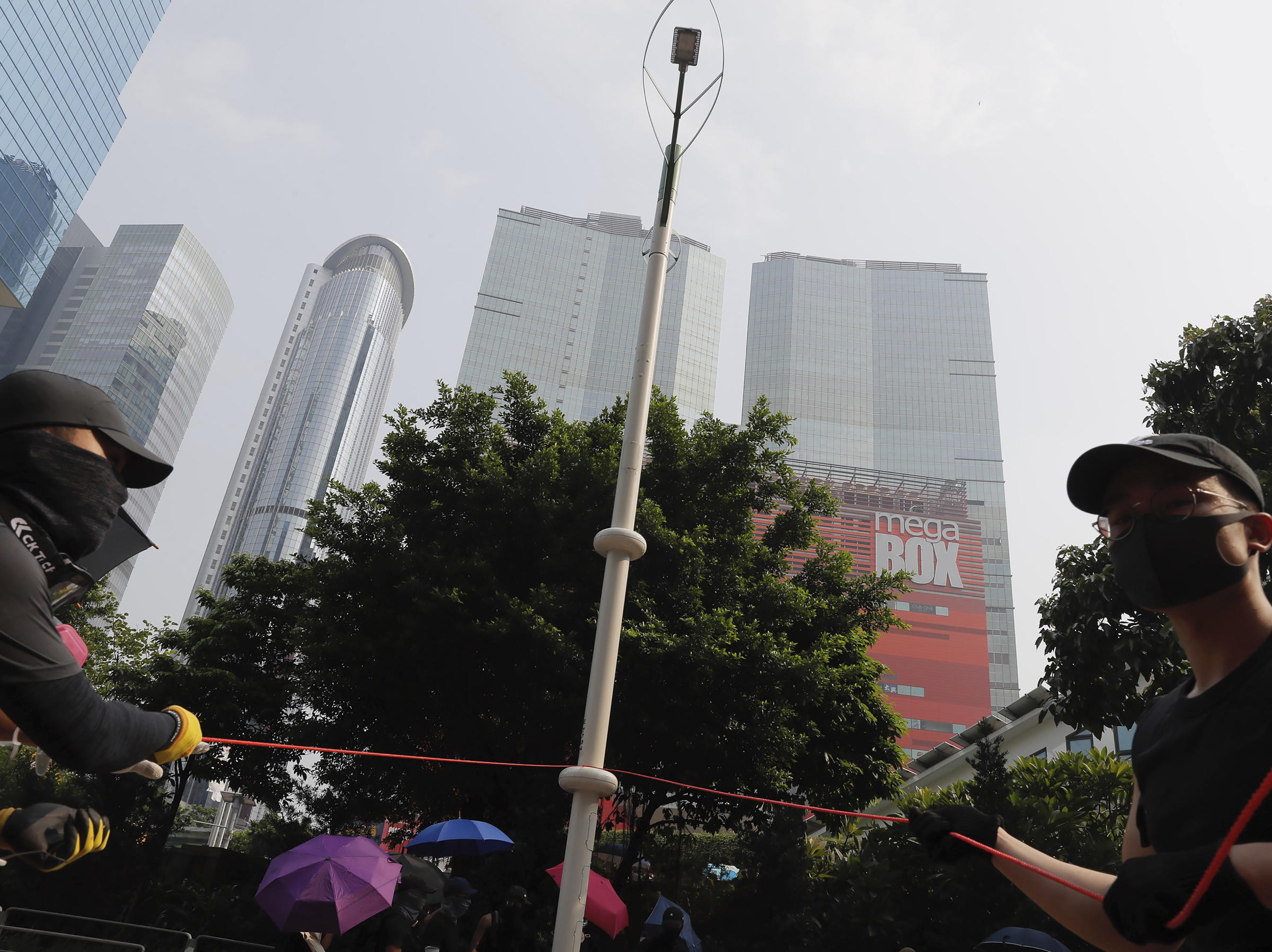 Violence Returns To Hong Kong As Police Fire Tear Gas And
