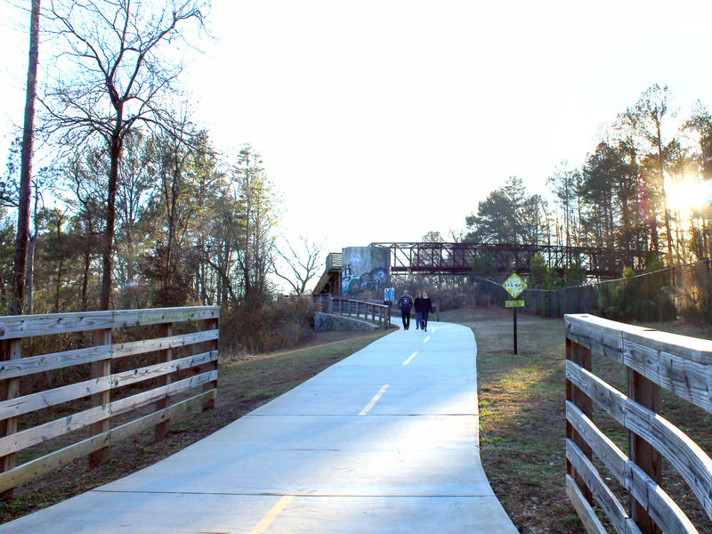 The South Peachtree Creek Trail winds over the railroad tracks to Mason Mill Park.