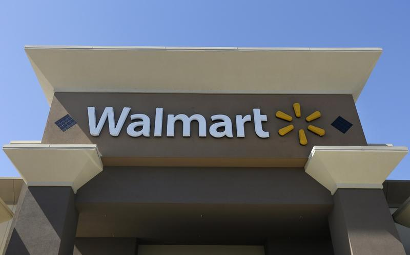 This Sept. 19, 2013 photo shows the sign of a Walmart store in San Jose, Calif.