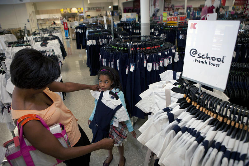 Phoenix Anderson, 6, of Chicago shops for school uniforms with her mother Dana at Kmart on Addison Avenue in Chicago.
