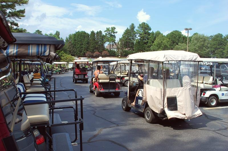 Not long after the bell rings at McIntosh High School in Peachtree City, a golf cart traffic jam forms at the far end of the parking lot.
