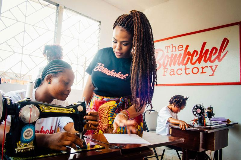 Archel Bernard, right, began The Bombchel Factory to help Liberian women learn sewing skills.