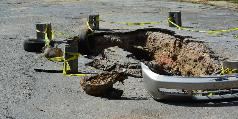 A sink hole has developed in the middle of Brannon Hill Condominiums.