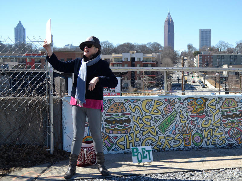 Lee Butler stands just off the Atlanta Beltline over North Avenue to read her poems to passersby.