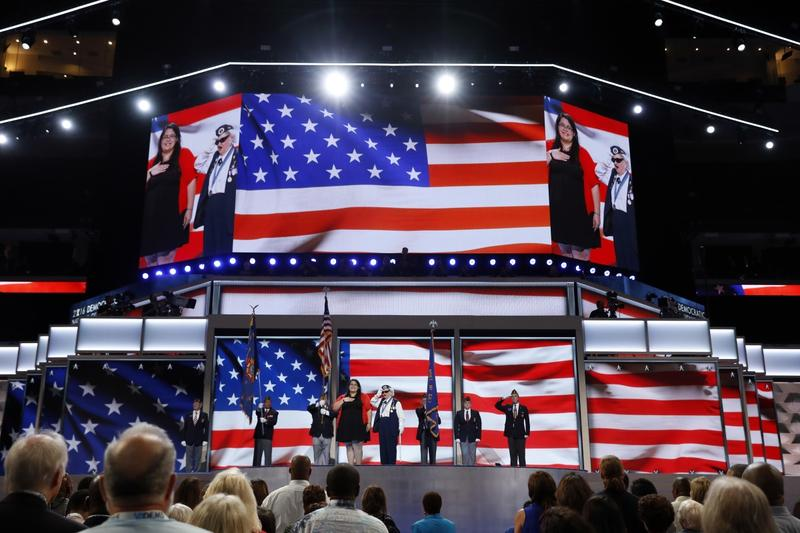 Youngest delegate 17-year-old Clarissa Rodriguez of Texas and the oldest delegate 93-year-old Ruby Gilliam of Ohio deliver the pledge of Allegiance during the first day of the Democratic National Convention in Philadelphia , Monday, July 25, 2016.