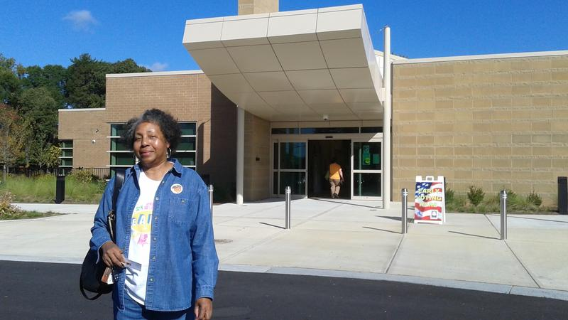 Ronda Hinton said it took her 20 minutes to vote early because there was confusion over whether she was registered to vote. She successfully cast hear ballot early in Fulton County at the Southeast Atlanta Public Library on Tuesday.