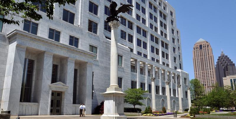 Pedestrians enter the Federal Reserve Bank of Atlanta, Friday, April 24, 2009 in Atlanta.