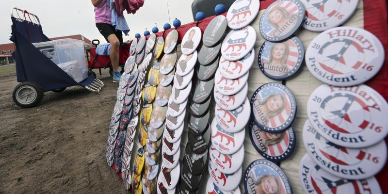 Linda Hague, of Kansas City, MO, loads merchandise to sell at a campaign event with Vice President Joe Biden and Democratic presidential candidate Hillary Clinton, Friday, July 8, 2016, in Scranton, Pa.
