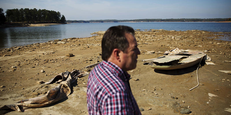 A sunken boat is exposed by receding water levels on Lake Lanier. Rainfall is expected Monday night, but water restrictions are expected to stay in place through the winter months.