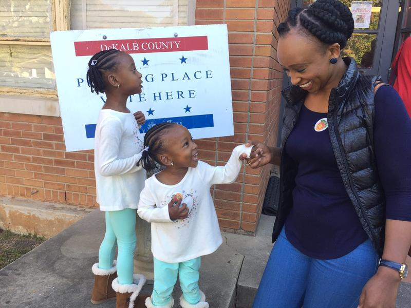 Nadia Mwangachuchu with her two daughters. Mwangachuchu, a former refugee from Democratic Republic of Congo, became a first-time voter this year.