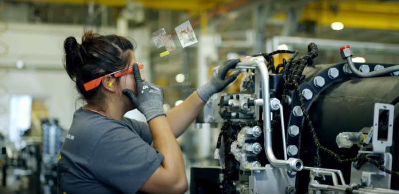 A factory worker in Jackson, Minnesota uses Google Glass to help her on the assembly line.