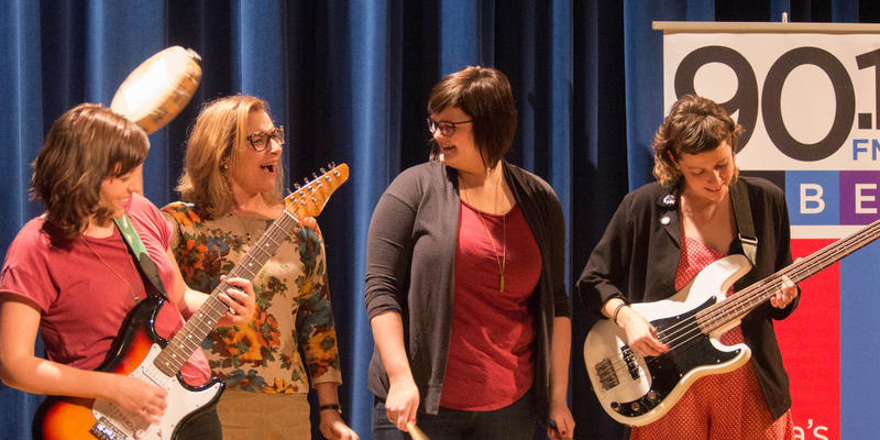 """Lois Reitzes jams out with a tambourine with band """"Lois Righteous"""" members Lisa Highfill (left), Beth Cunningham (center right) and Whitney Hansen (right)."""