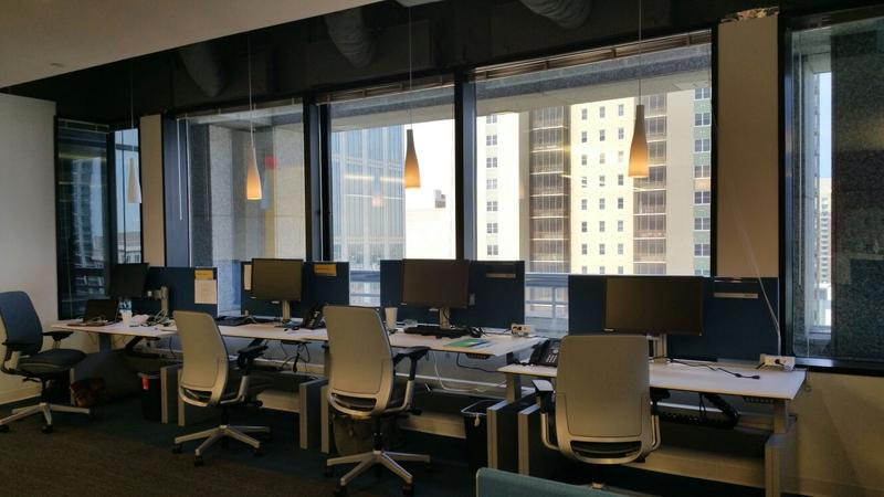 Many desks sit empty at SunTrust Bank corporate headquarters in Midtown Atlanta. In addition to cubicles and offices, there are rows of mobile workstations. Employees without assigned desks said it reduces the need to be physically present.