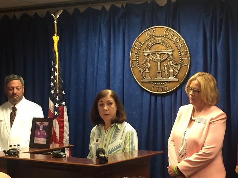 Robin Cardiges, whose son died of an opioid overdose, speaks next to state Sen. Renee Unterman.