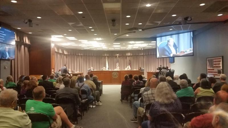 Cobb County taxpayers at a meeting last month in which the county commissioners voted not to raise the property tax rate. Commission Chairman Mike Boyce wanted to raise the county millage rate by .13 to meet budget needs.