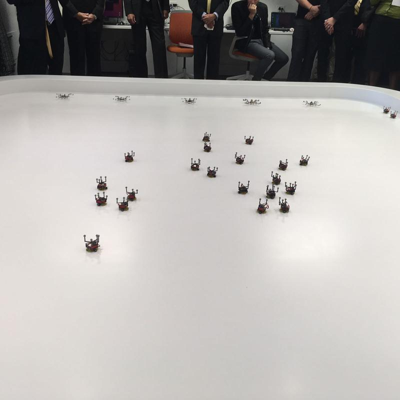 These swarm robots work together to figure out where to position themselves to complete a task. They end up forming the letters G and T for Georgia Tech.