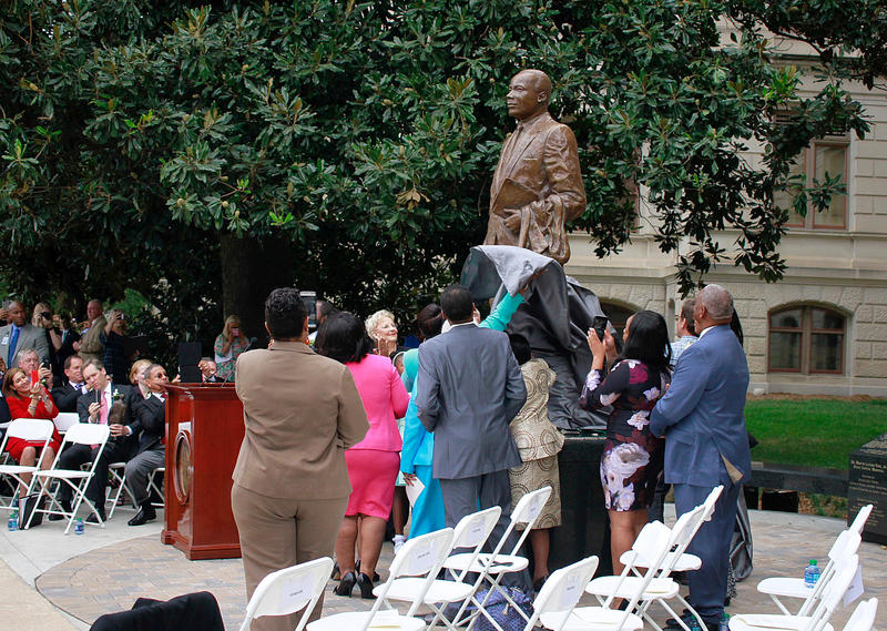 A statue of Martin Luther King Jr. was unveiled at Georgia's state Capitol Monday.