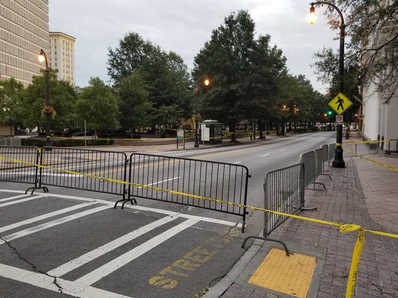 The area around 34 Peachtree Street in Downtown Atlanta has been closed off due to storm winds knocking metal panels off the tower.