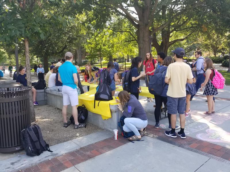 "Georgia Tech students gather to write notes to Scout Schultz's family and the Georgia Tech Police Department at a ""come together"" event on campus Tuesday."