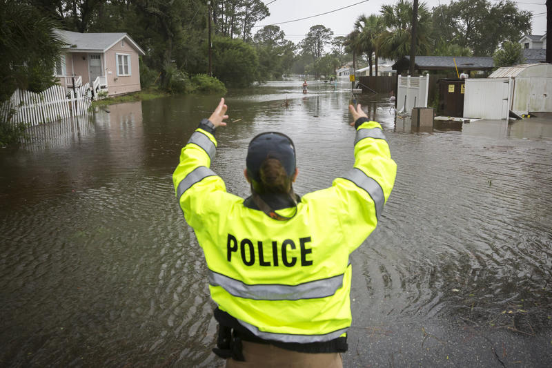 A City of Tybee police officer checks the well being of a resident fleeing her flooded home on Tybee Island on Monday. Parts of the coastal Georgia island suffered from Tropical Storm Irma.