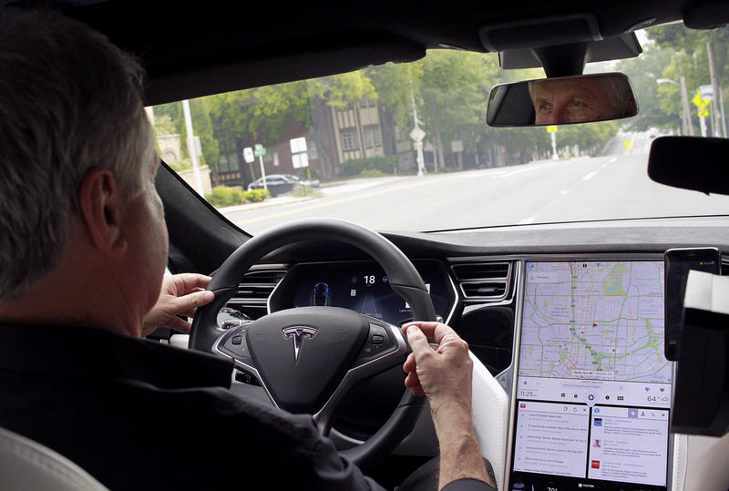 Bryan Mulligan, president of Applied Information, shows off how the semi-autonomous Tesla P100D navigates North Avenue.