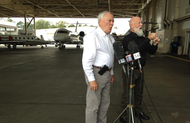 Gov. Nathan Deal speaks to reporters after landing at DeKalb-Peachtree Airport. He flew around Georgia on Thursday, looking at Irma's impact on the state.
