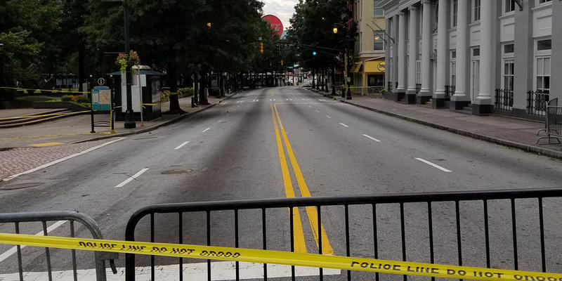 The section of Peachtree Street beside Woodruff Park was closed off until Thursday because of falling metal panels.
