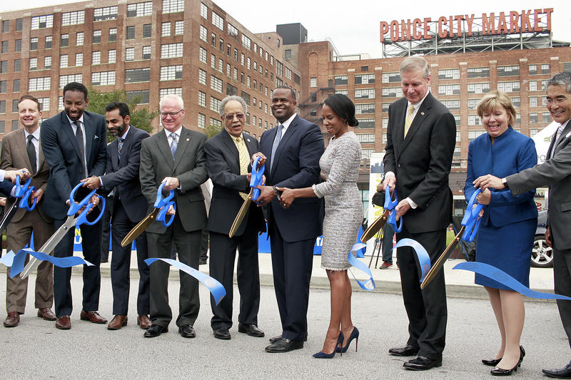 Atlanta Mayor Kasim Reed and others help cut the ribbon on the grand opening of the Smart Corridor on North Avenue.