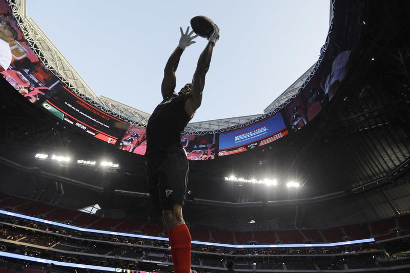 Atlanta Falcons' Marcelis Branch warms up Sunday, and the retractable roof at Mercedes-Benz Stadium was opened for the game. The Falcons scored a win Sunday and the Atlanta United set a record Saturday at their new home.