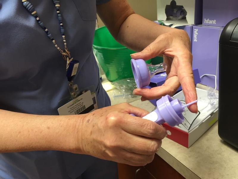 Emory University Hospital physical therapist June Garber shows off the nfant feeding solution bottle she uses with her smallest patients in the NICU.