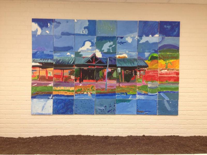 Paint Love partners with nonprofits and schools to create art with kids like this mural at Norton Park Elementary School.