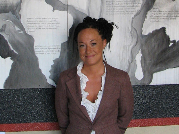 In this July 24, 2009, file photo, Rachel Dolezal, a leader of the Human Rights Education Institute, stands in front of a mural she painted at the institute's offices in Coeur d'Alene, Idaho. Dolezal, now president of the Spokane, Wash., chapter of the NA