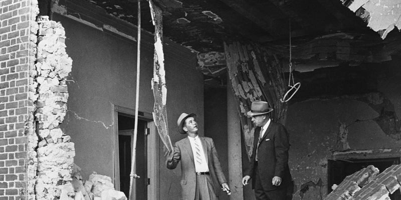 Detective Superintendent I. G. Cowan, right, and Detective W. K. Perry examine dynamite ruins at the Jewish Temple for clues in the explosion that did damage estimated at $200,000 in Atlanta on Oct. 13, 1958.