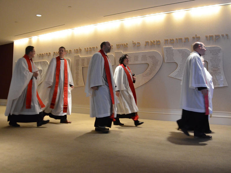 The Episcopal clergy walk pass a Hebrew sign at The Temple in Atlanta, Georgia on Tuesday, March 31, 2015. (Photo/Brenna Beech)