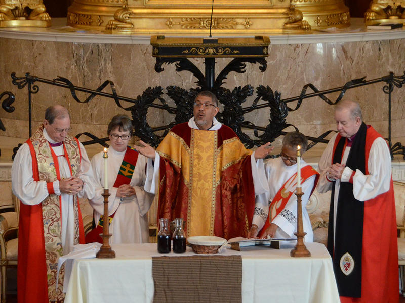 (left to right) Bishop Dawn Wimberley, Archdeacon Carole Maddux, Bishop Robert Wright, Archdeacon Janet Tidwell, and Bishop Keith Whitmore prepare to distribute communion at the renewal of vows for the clergy of the Episcopal Church at The Temple in Atlan