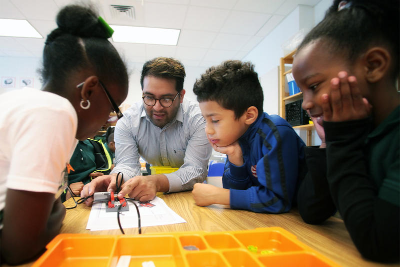 Students and teacher work in the robotics class at Charles R. Drew Charter School Elementary Academy.